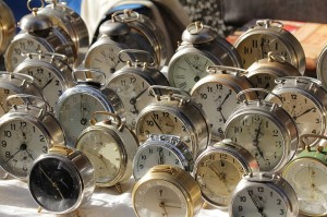 old alarm clocks in a market in italy