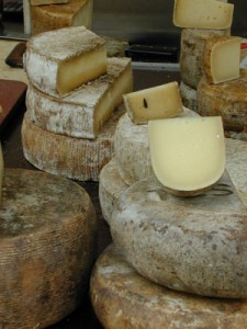 cheese wheels at a market in Basel