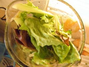 blender jug filled with lettuce leaves