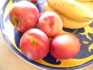 peaches, nectarines and an apple