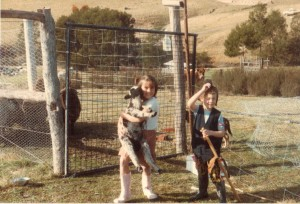 me and my brother holding a sheep on a farm