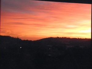 pink, orange sunrise on coast hill silhouette