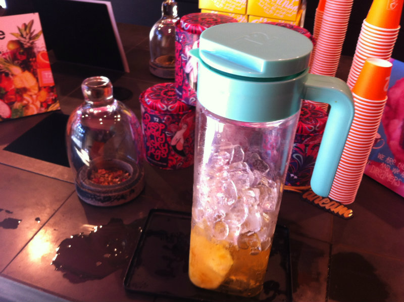 jug of iced tea and ice with tea and cups