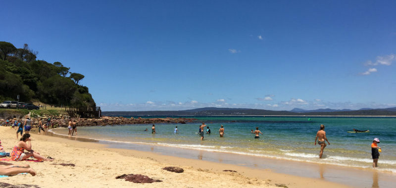 Blue Monday - beautiful beach day on holidays, people in the water at the beach